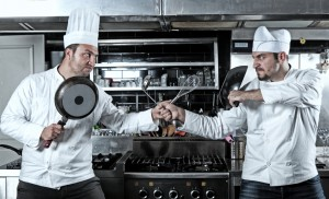 Portrait of two chefs fighting